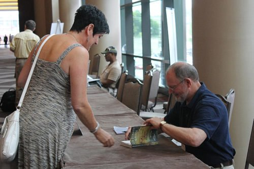 William Kent Krueger signs copies of his book.